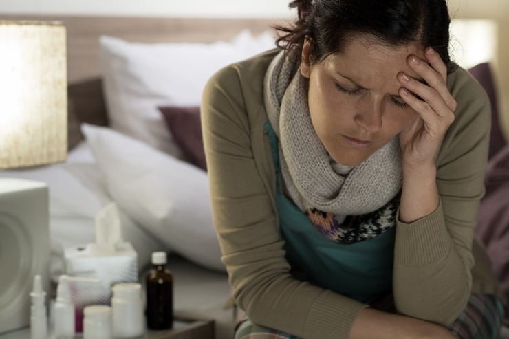 Ill woman with medicines suffer flu headache