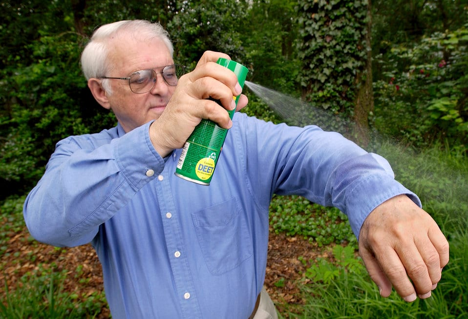 15764-a-man-spraying-insect-spray-on-his-shirt-pv